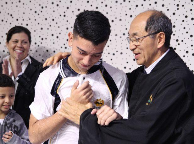 Batismo de aluno em evento [Foto: Michelle Martins]